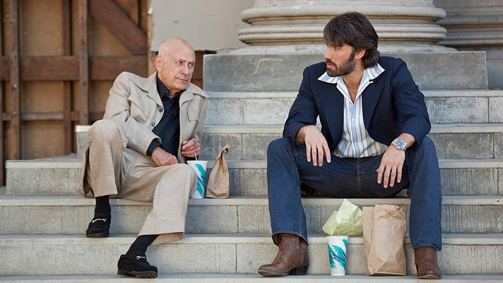 "Alan Arkin and Ben Affleck on the Warner Bros. Studio lot in a scene from ""Argo"""