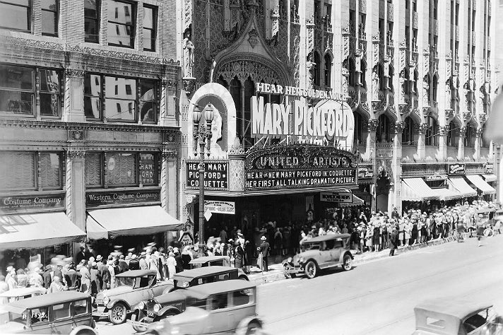 """Crowds line up for Mary Pickford's first talkie, """"Coquette"""" at the United Artists Theatre"""