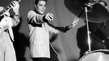Elvis on stage in black and white
