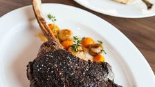 Dry-aged bone-in prime tomahawk steak at The Arthur J