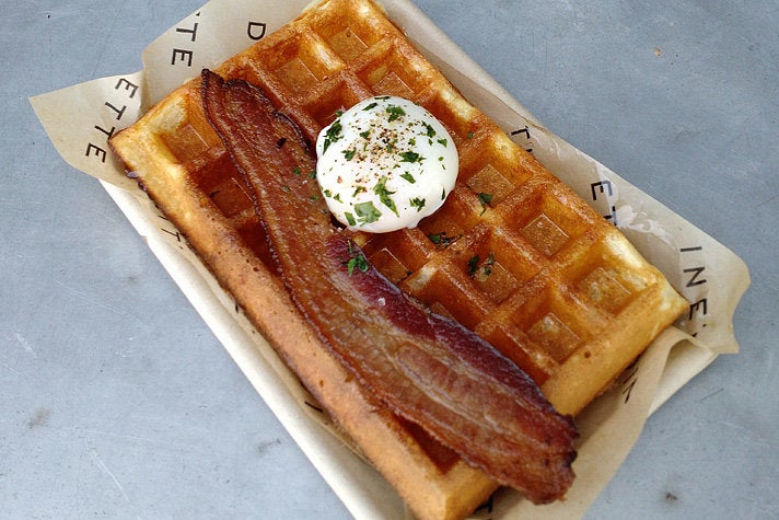 Waffle with Nueske's bacon and poached egg at Dinette